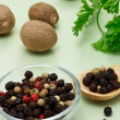 Colorful peppercorn with nutmegs — Stockfoto #8486471