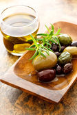 Olive oil and mixed olives — Stock Photo