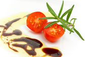 Tomato with balsamic vinegar — Stock Photo