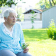 Senior lady relaxing outside — Stock fotografie #8554405
