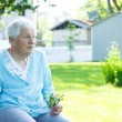 Foto Stock: Senior lady relaxing outside