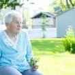 Senior lady relaxing outside — Stock Photo #8554424