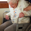 Caregiver helping senior lady — Stock Photo