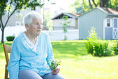 Senior lady relaxing outside — Stock Photo