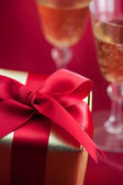 Gift box with champagne — Stock Photo