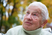 Senior lady outside in fall — Stock Photo