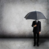 Business man with umbrella — 图库照片
