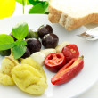 Foto Stock: Pickled Olives and Peppers