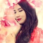 Beautiful Girl in Elegant Flowers — Stock Photo