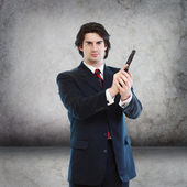 Handsome Man with a Hand Gun — Stock Photo