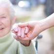 Senior Lady and Young Woman Holding Hands — Stock Photo