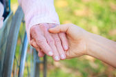 Senior and Young Women Holding Hands — Foto de Stock