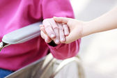 Senior Lady in Wheelchair Holding Hands — Stock Photo