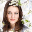 Foto Stock: Beautiful Girl with Blooming Tree