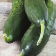 Cucumber on wood table — Stockfoto