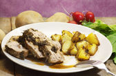 Roast calfe dressed with aromatic herbs, balsamic vinegar and po — Stockfoto