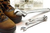 Safety shoes with open-end spanner and screw — Zdjęcie stockowe