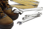 Safety shoes with adjustable spanner and folding rule — Stock Photo