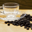 Coffee beans with empty cup — Foto de Stock