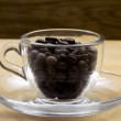 Coffee cup stuffed with coffee beans — Stock Photo