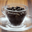 Royalty-Free Stock Photo: Coffee cup stuffed with coffee beans