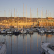 Stock Photo: Trieste and sailboats at sunset