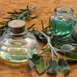 Sage and rosemary essential oil — Stock Photo