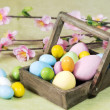 Easter eggs on a wood basket — ストック写真