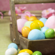 Easter eggs on a wood basket — Stok fotoğraf