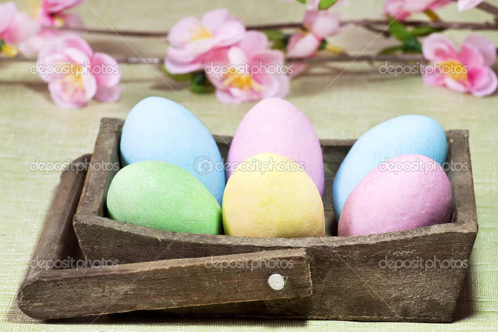 Easter colorful eggs on a wood basket — Lizenzfreies Foto #9740758