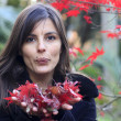 Brunette woman with red autumnal leaves — Stock Photo