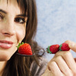 Smiling woman ready to eat strawberry — Stock Photo