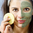 Stock Photo: Facial mud beauty treatment