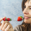Beautiful girl eating strawberry — Stock Photo