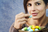 Attractive woman eating easter eggs — Stock Photo