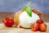 Mozzarella with parma ham, tomatoes and basil — Stock Photo