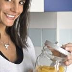 Woman opens pasta stuffed airtight jar — Stock Photo