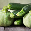 Raw zucchini and raw round zucchini — Stock Photo
