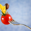 Fork with pasta, tomato and olive — Stock Photo #9969289