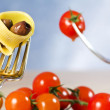 Fork with pasta, tomato and olive — Stock Photo #9969642