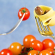 Fork with pasta, tomato and olive — Stock Photo