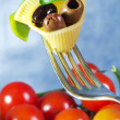 Fork with pasta,basil and olive — Stock Photo #9969853