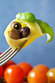 Fork with pasta,basil and olive — Stock Photo
