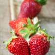 Fresh strawberries on wood — Stock Photo