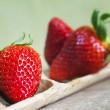 Strawberries on wood — Stok fotoğraf