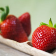 Strawberries on wood — Stockfoto