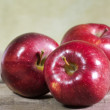 Red apples on wooden table — Foto Stock