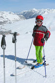 Child on skis and helmet — Stock Photo