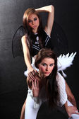Demon and angel — Stock Photo