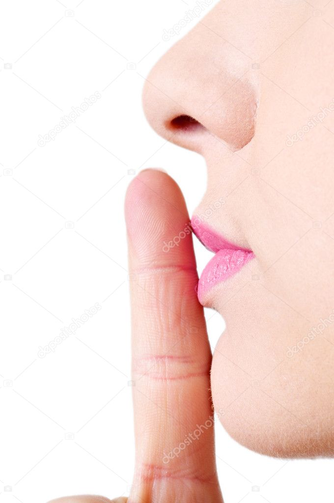A young female making a sign to keep quiet.  Stock Photo #10006601